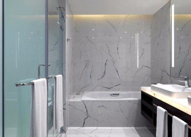 bathroom toilet sink plumbing fixture shower white bathtub tiled stall tile water basin