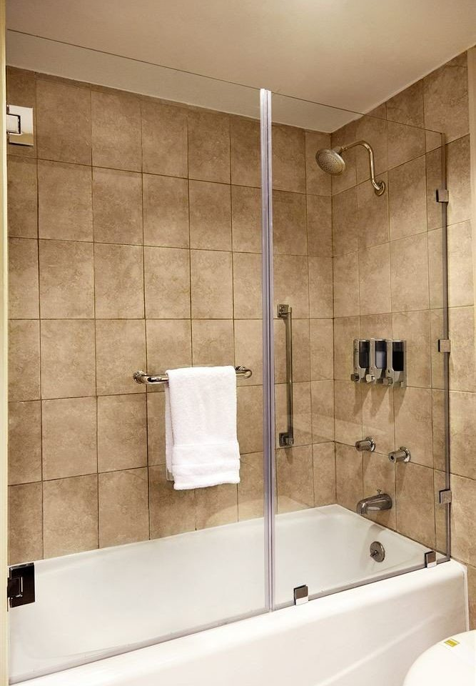 bathroom vessel plumbing fixture sink bathtub tile shower tan