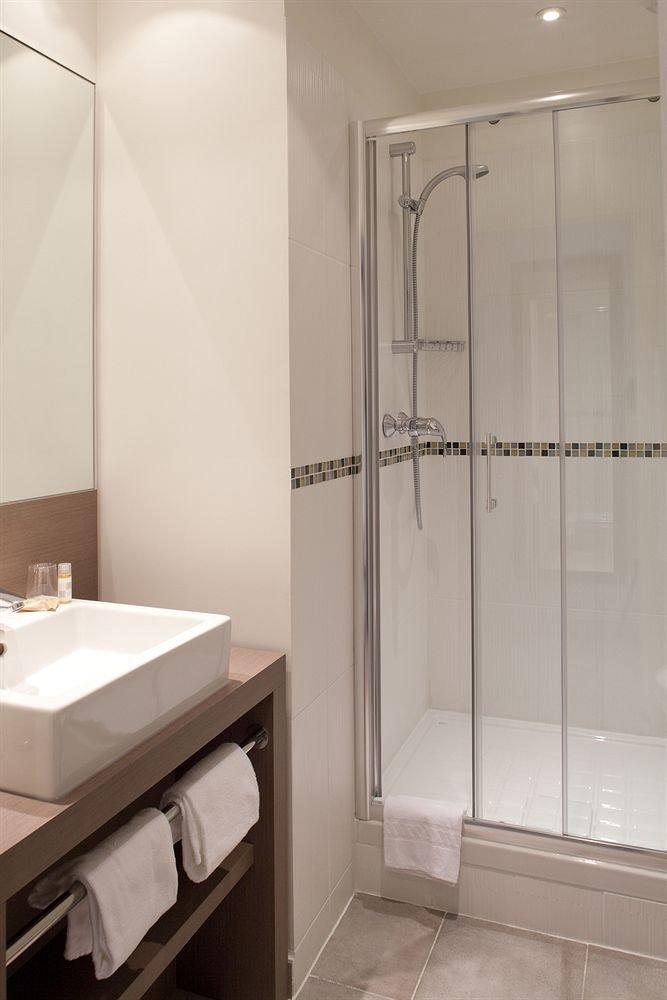bathroom sink plumbing fixture toilet tub bathtub tiled