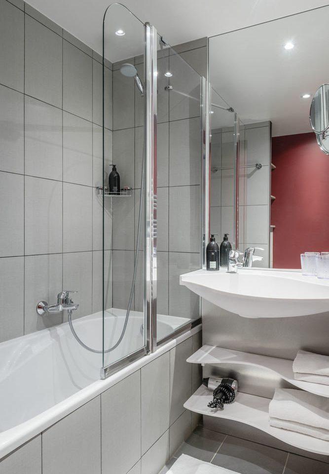bathroom sink plumbing fixture toilet white vessel bathtub tiled tile