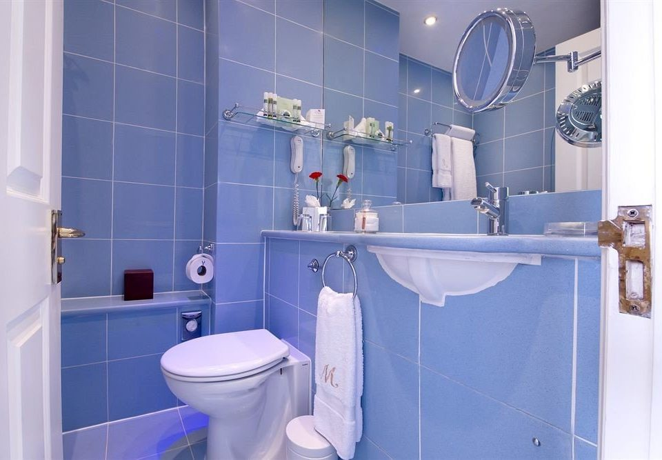 bathroom blue toilet white plumbing fixture public toilet bidet tile painted tiled