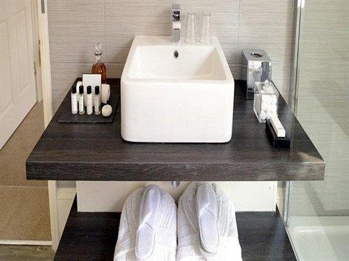 sink bathroom countertop plumbing fixture toilet bidet flooring ceramic material