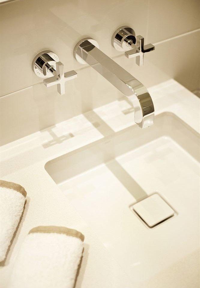 white sink bathroom plumbing fixture toilet bidet tap ceramic flooring