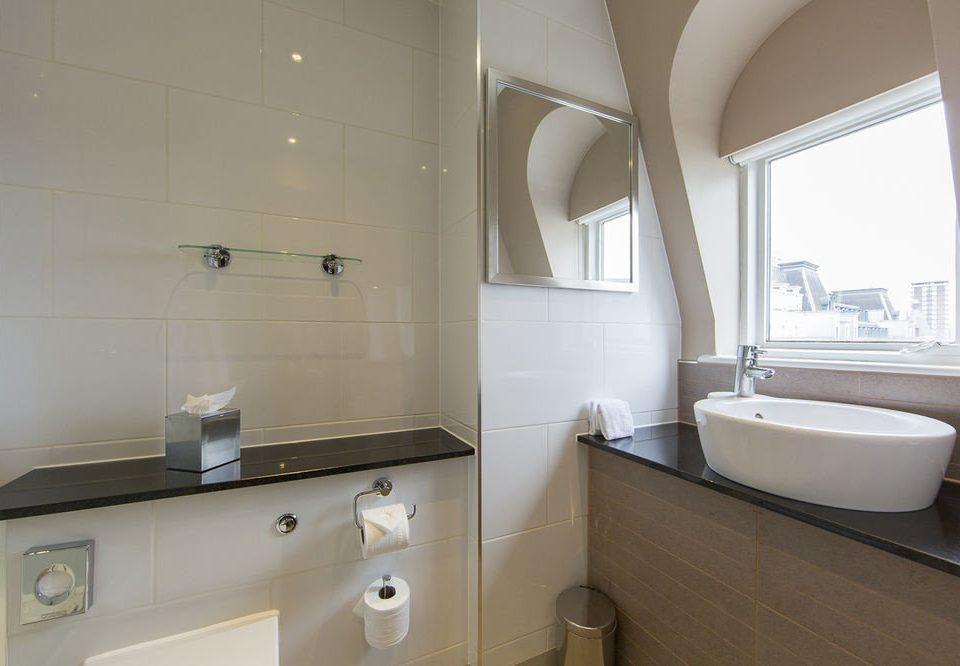 bathroom mirror property sink toilet home bidet clean tiled