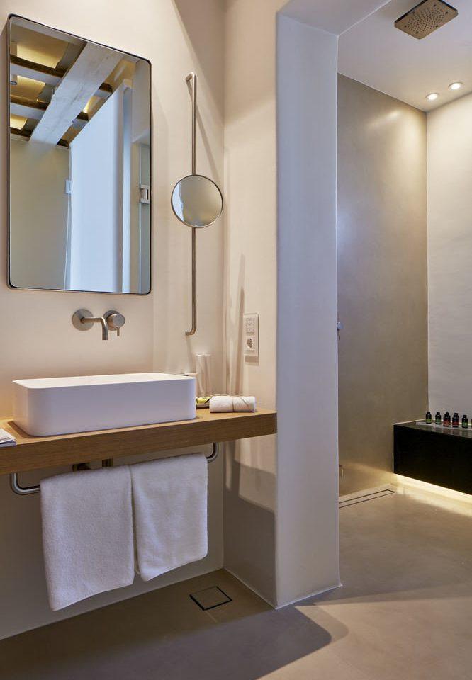bathroom mirror property sink plumbing fixture bidet clean