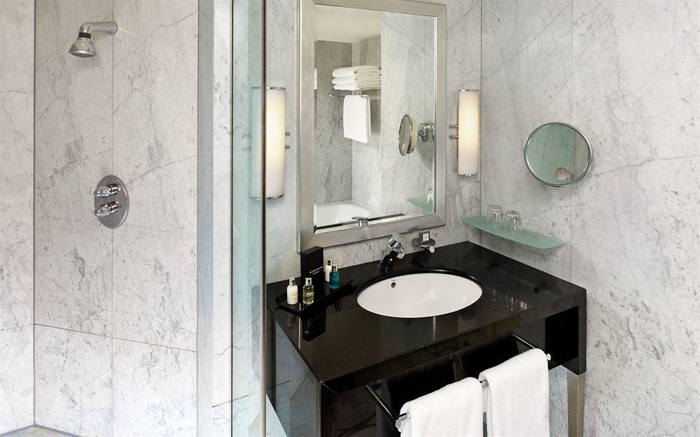 bathroom sink property home plumbing fixture toilet cottage tile bidet flooring public toilet tiled