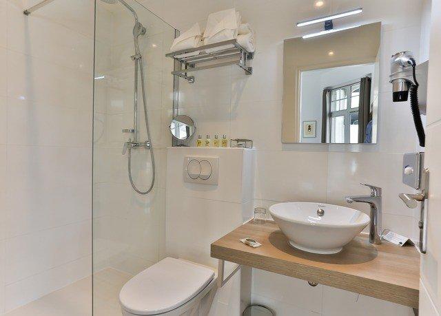 bathroom sink mirror property scene toilet shower home bidet cottage rack plumbing fixture