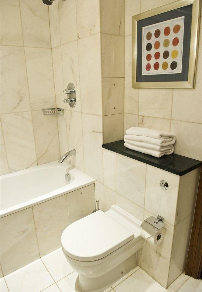bathroom property toilet bidet plumbing fixture home sink cottage tile tiled