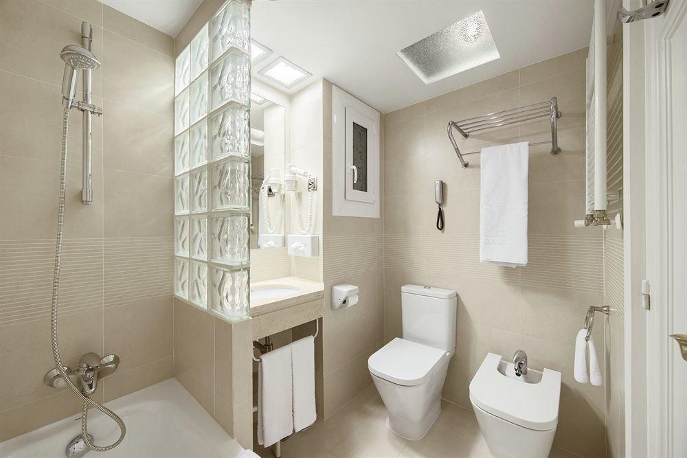 bathroom mirror sink property toilet towel home cottage bidet plumbing fixture rack