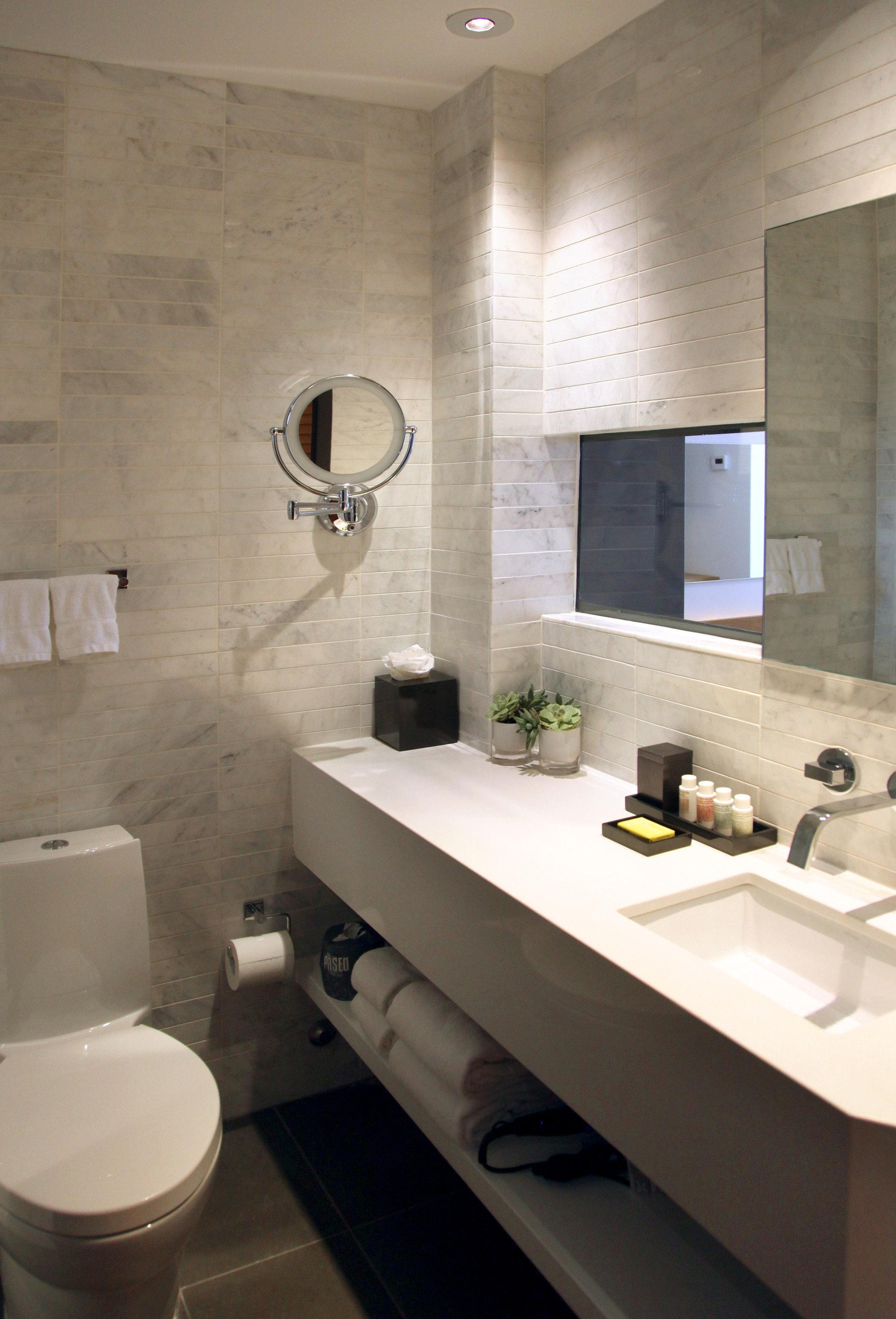 bathroom sink property toilet home plumbing fixture flooring bidet tile countertop