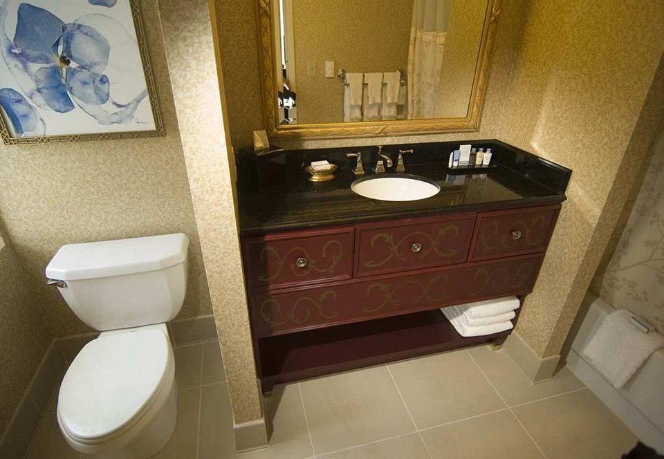 bathroom toilet mirror property sink plumbing fixture home flooring bidet countertop rack