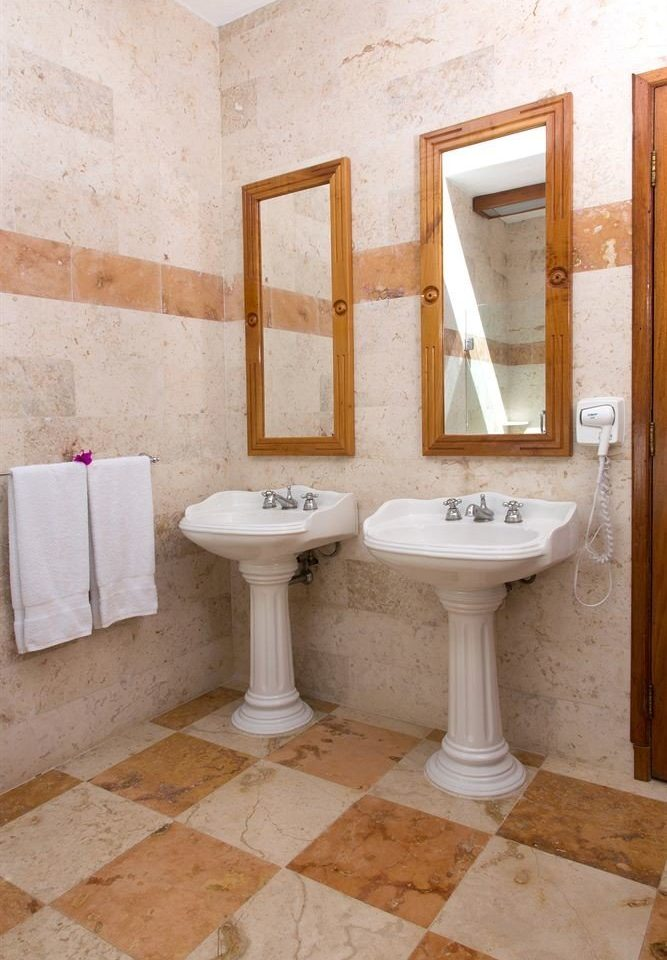 bathroom sink property structure plumbing fixture flooring tile bidet tiled painted dirty