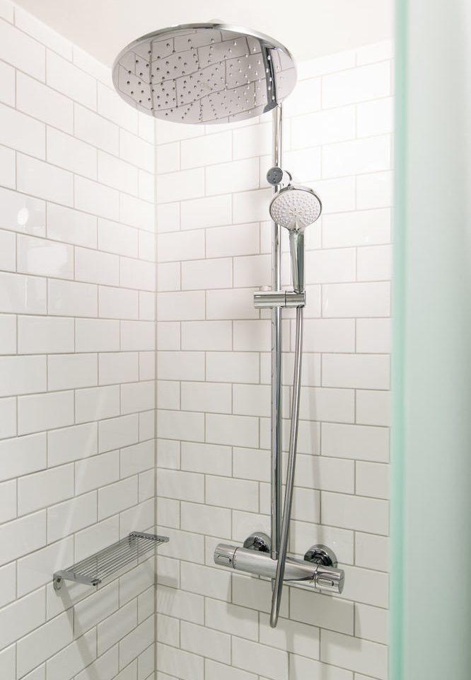 plumbing fixture shower bidet bathroom tap toilet sink public tiled tile dirty