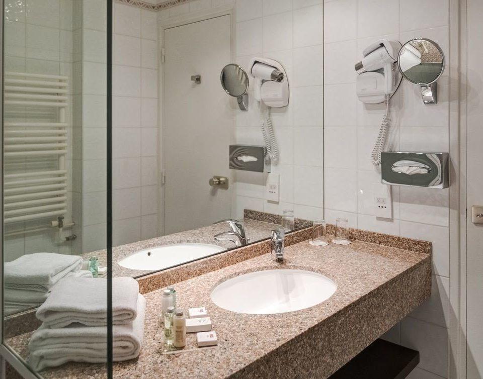 bathroom sink property mirror toilet home plumbing fixture bidet flooring tiled