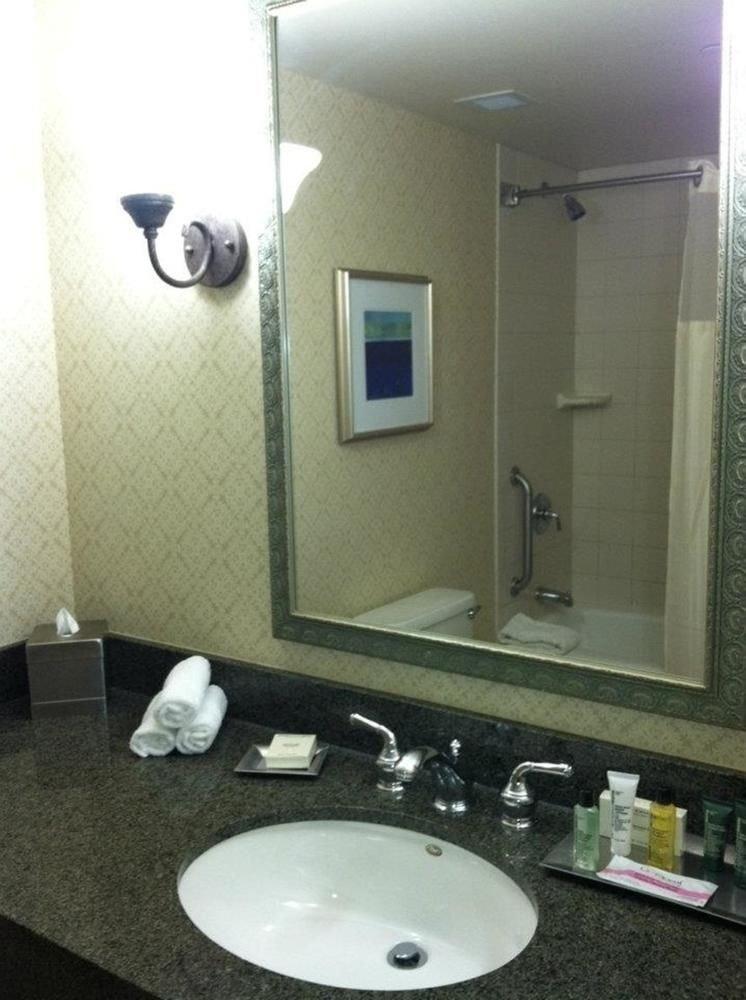 bathroom sink mirror property plumbing fixture toilet home towel public toilet bidet flooring