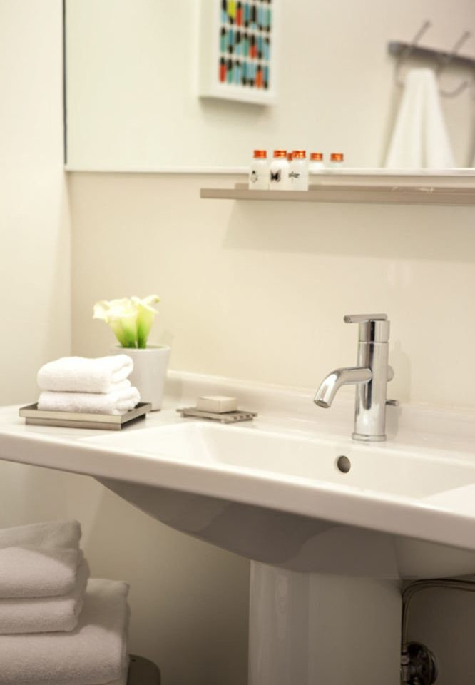 bathroom white sink home plumbing fixture toilet bidet flooring