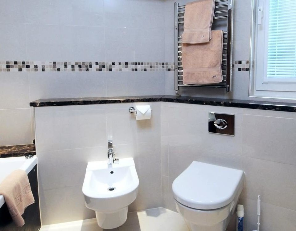 bathroom toilet property white bidet home flooring