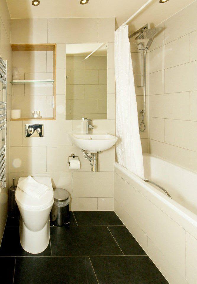 bathroom toilet property home sink plumbing fixture flooring bidet tile tiled