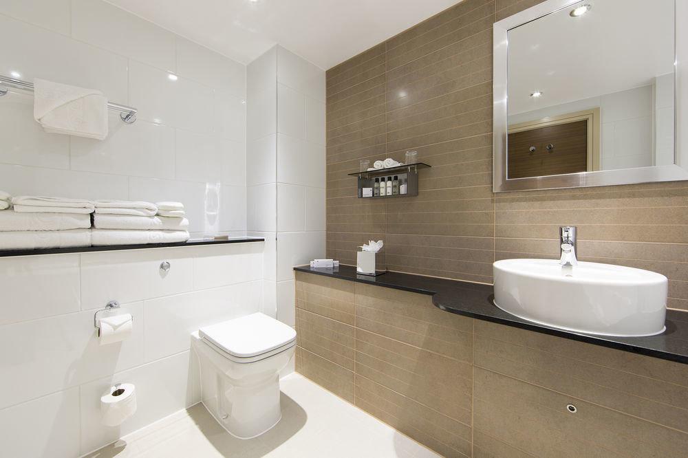 bathroom mirror sink property toilet bidet flooring tile rack