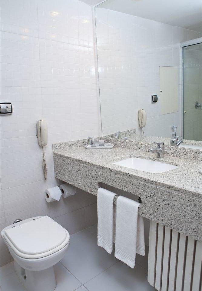 bathroom sink toilet mirror property bidet flooring plumbing fixture tile public toilet