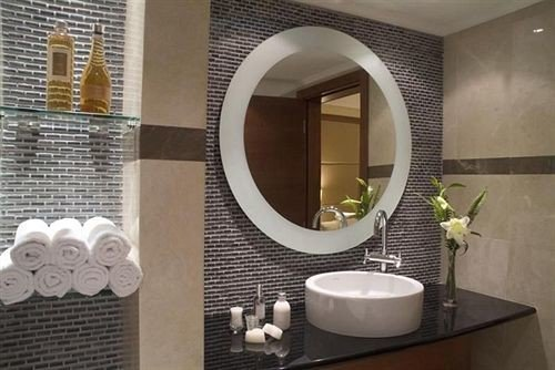 bathroom mirror sink plumbing fixture bidet flooring tile tiled