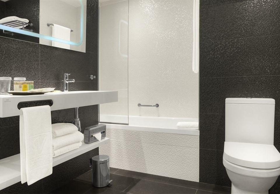 bathroom white mirror property sink toilet bidet plumbing fixture flooring towel