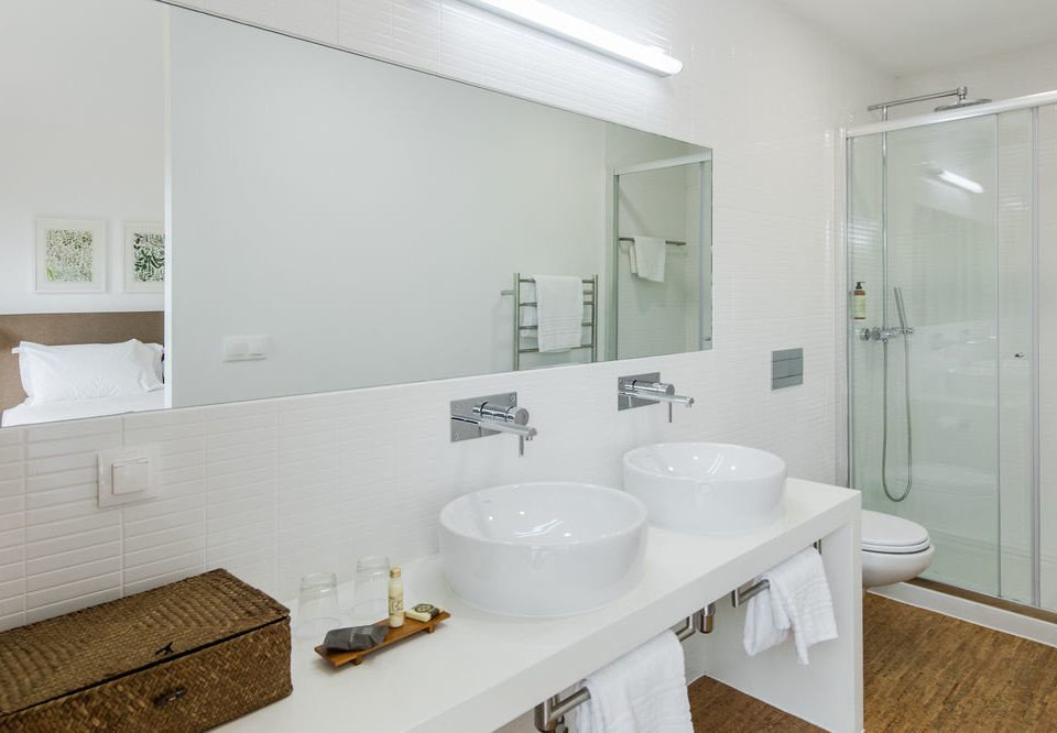 bathroom mirror sink property flooring plumbing fixture bidet toilet