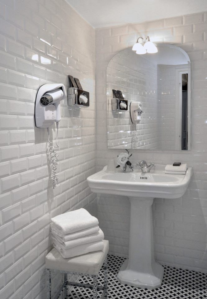 bathroom white sink bidet plumbing fixture flooring toilet