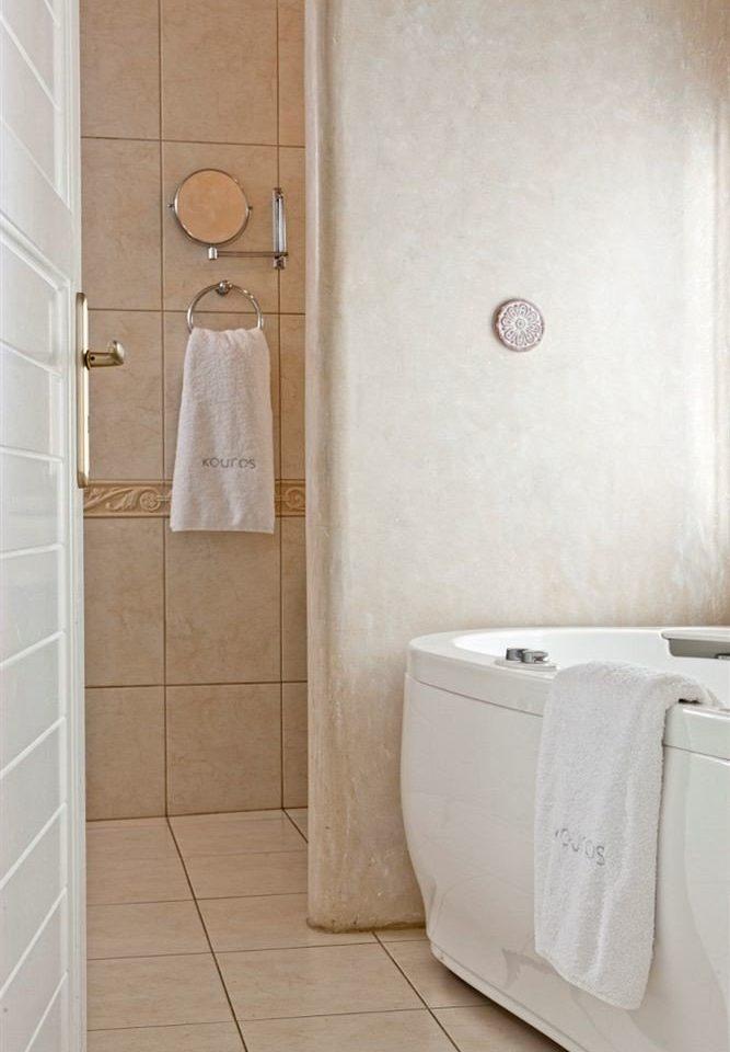 bathroom plumbing fixture toilet flooring tile bidet shower public toilet tan