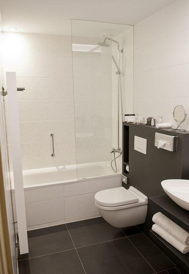 bathroom property plumbing fixture toilet bidet flooring tile tiled