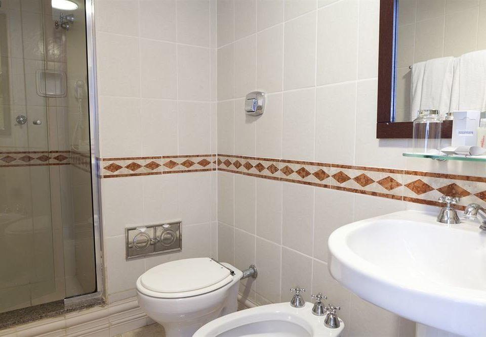 bathroom sink toilet property bidet plumbing fixture flooring tile tiled