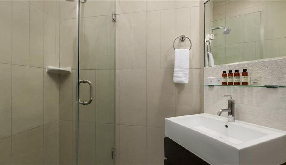 bathroom property plumbing fixture sink bidet flooring water basin tiled