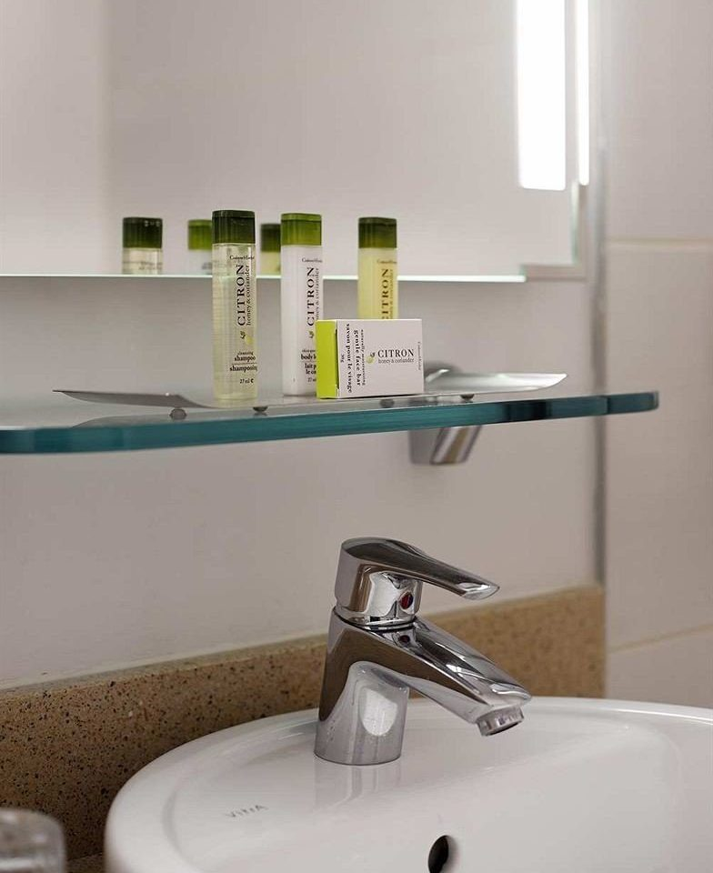 bathroom sink shelf plumbing fixture bidet tap flooring toilet water basin