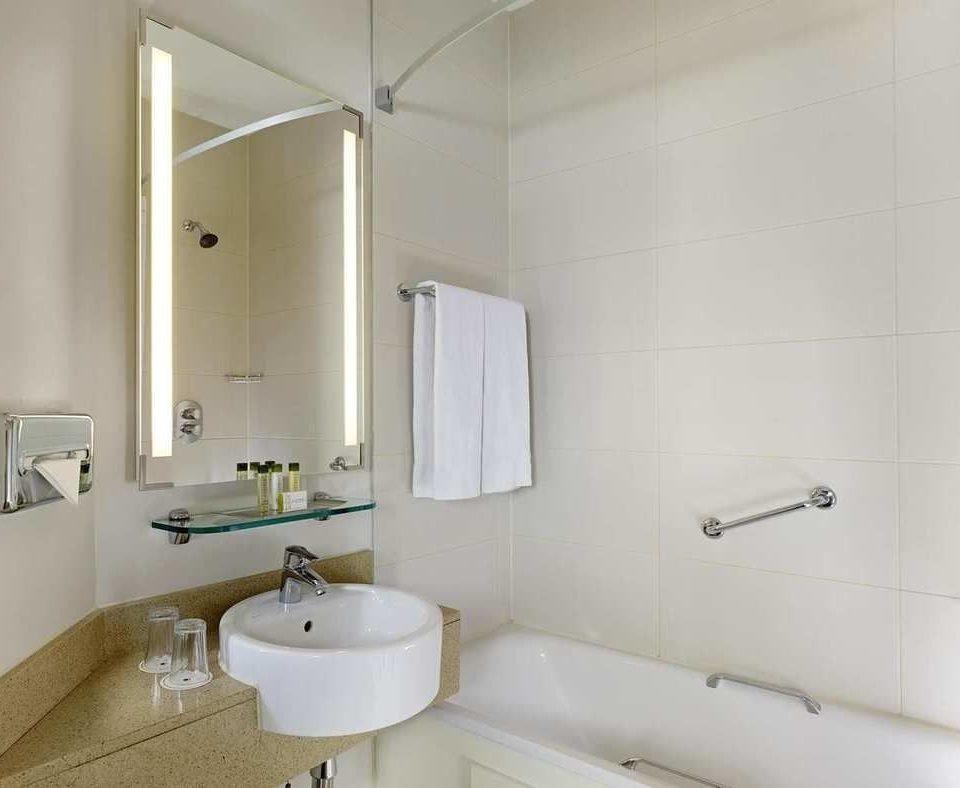 bathroom property toilet sink bidet plumbing fixture flooring tan