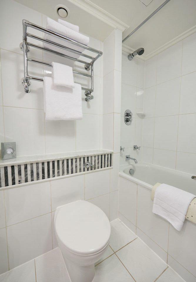 bathroom property toilet bidet flooring plumbing fixture tiled tile