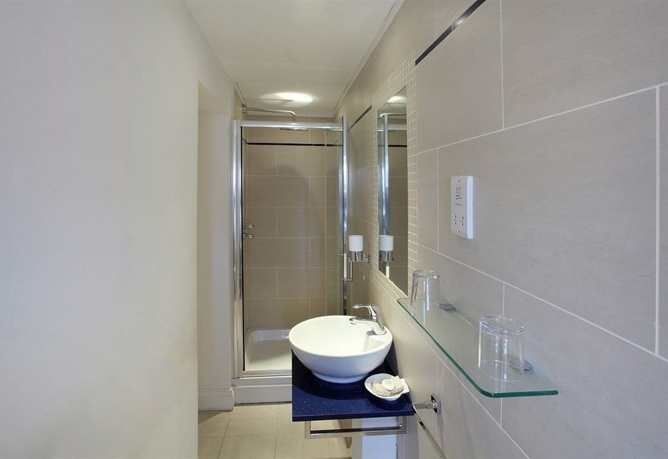 bathroom property toilet sink flooring plumbing fixture bidet tile tiled