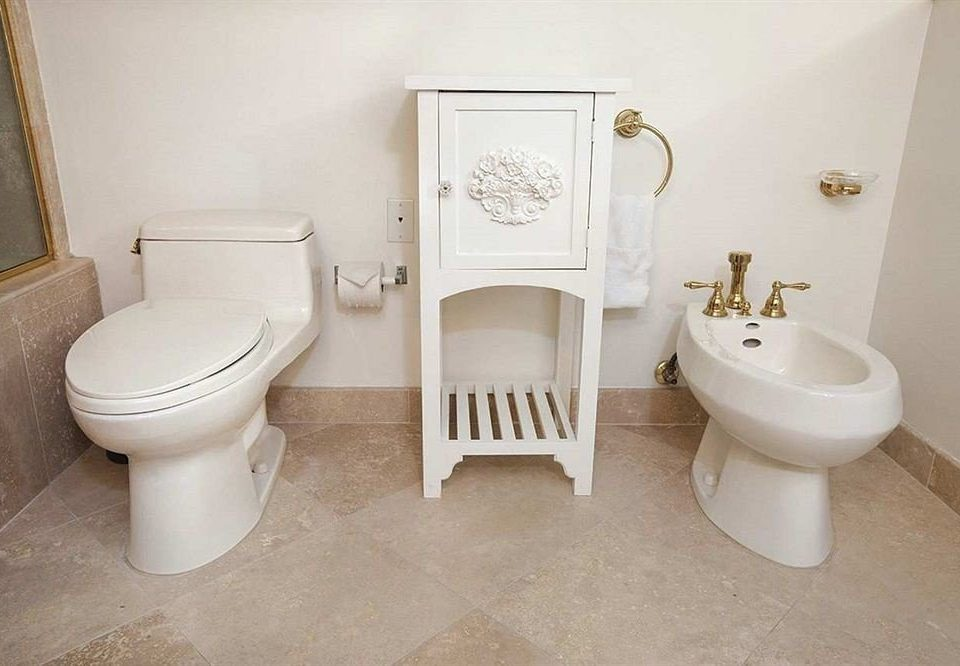bathroom toilet property plumbing fixture bidet white flooring sink toilet seat trash