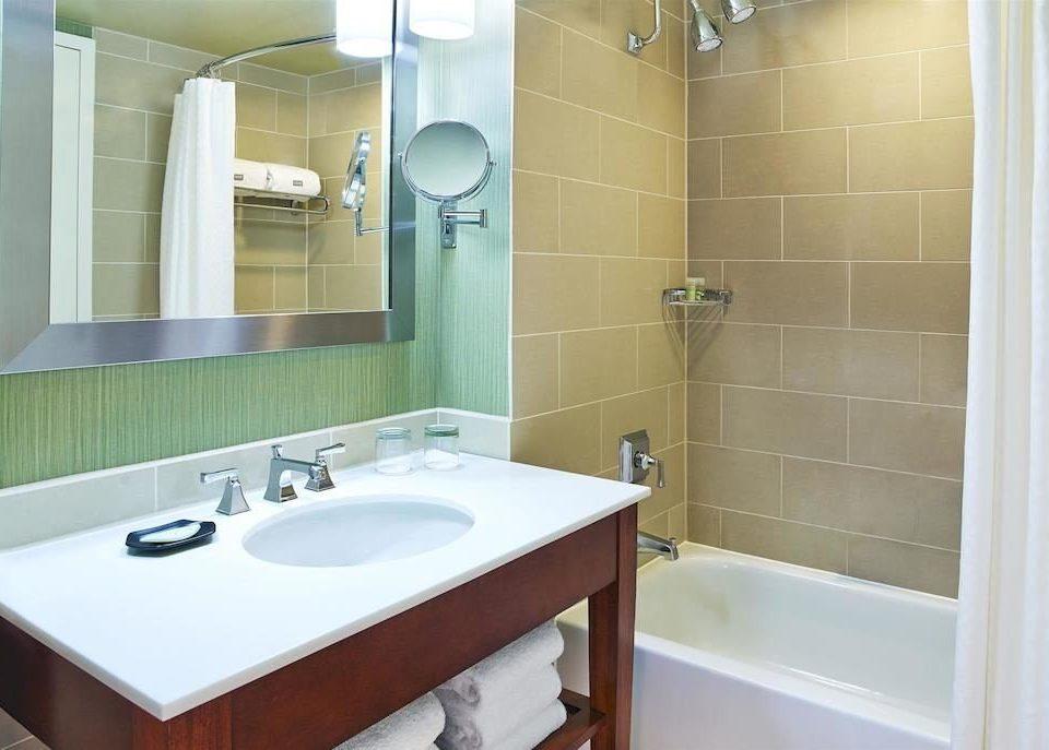 bathroom sink mirror property home plumbing fixture bidet tile tan tiled