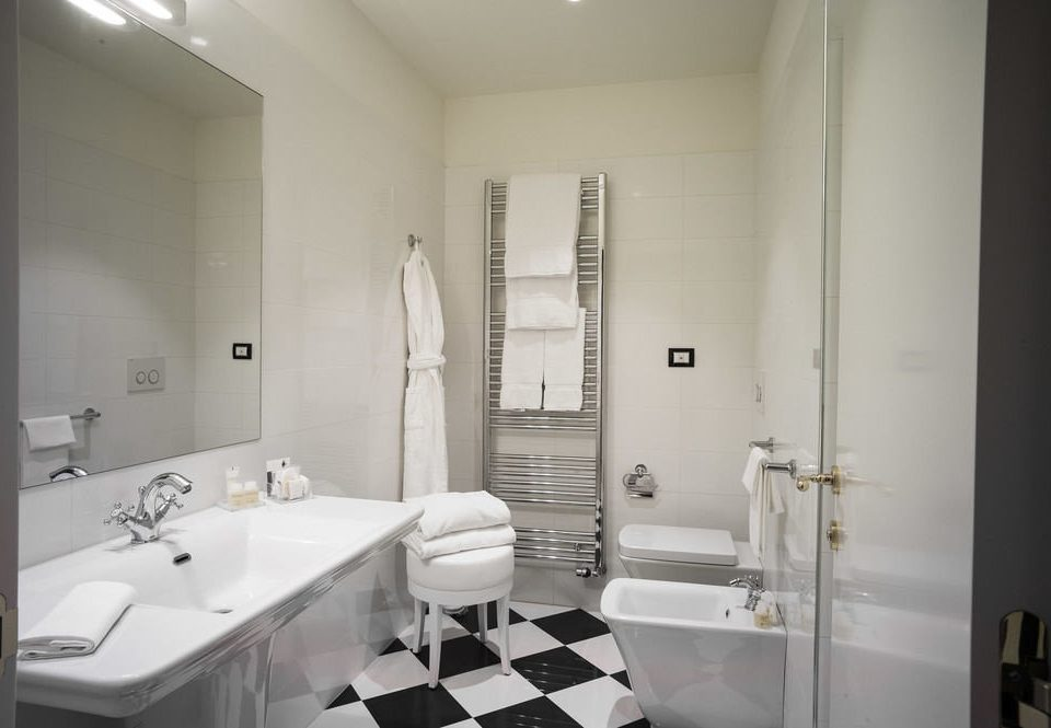 bathroom mirror sink property toilet white home plumbing fixture bidet tile tiled