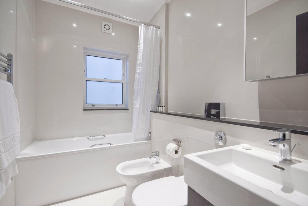 bathroom mirror sink property white toilet home bidet