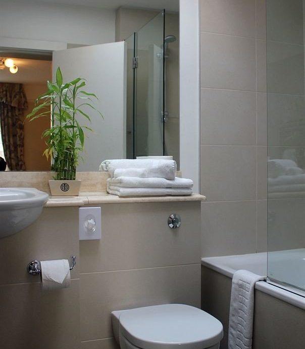 bathroom toilet property sink plumbing fixture bidet home tiled