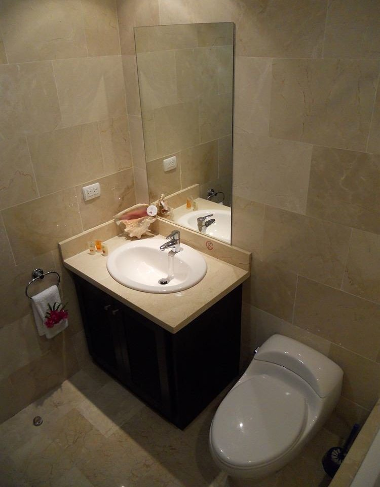 bathroom property sink house white toilet bidet plumbing fixture swimming pool public tiled