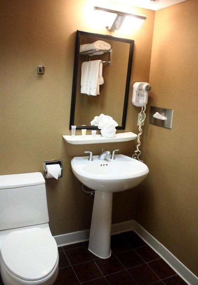 bathroom sink property mirror toilet plumbing fixture bidet towel rack tiled