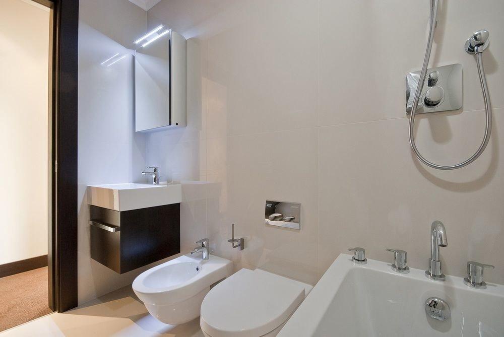 bathroom mirror sink vessel property toilet bidet white plumbing fixture water basin tile