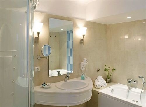 bathroom sink property mirror white shower toilet bidet plumbing fixture tan