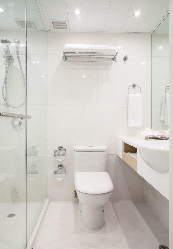 toilet bathroom property plumbing fixture bidet white