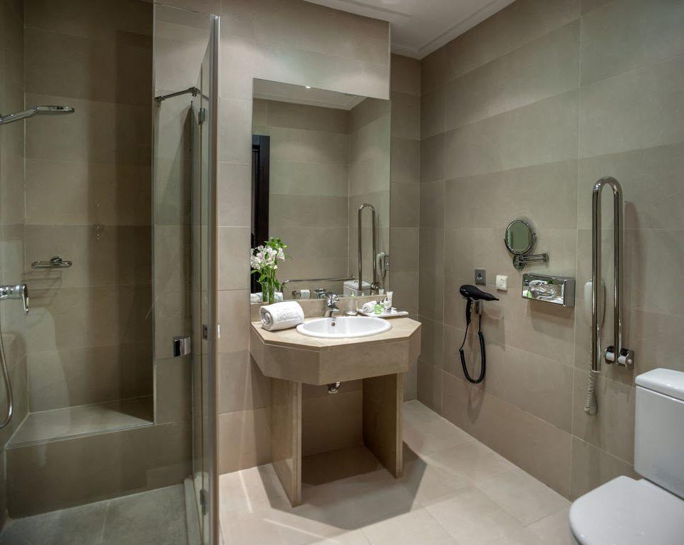 bathroom sink property toilet bidet plumbing fixture tile