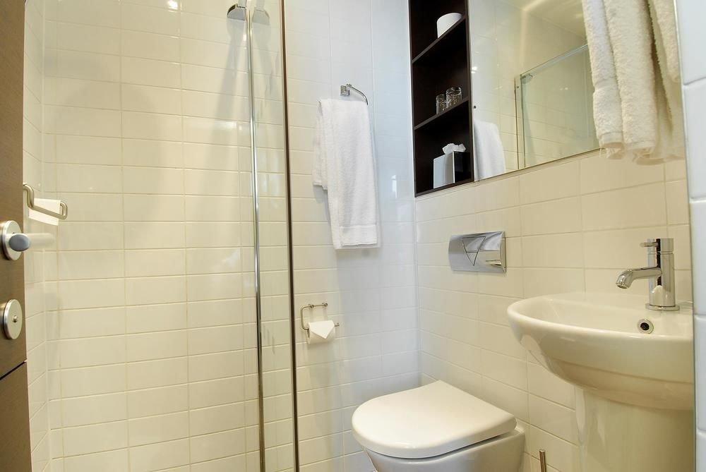 bathroom property sink toilet plumbing fixture white bidet public toilet tan