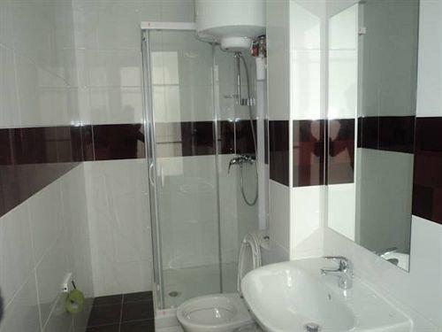 bathroom property scene white plumbing fixture bidet sink tiled tile