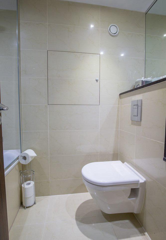 bathroom property toilet plumbing fixture sink bidet public toilet tiled tile